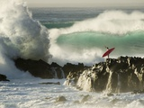 Surf Crashing near Surfer on Boulders Metal Print by Mark A. Johnson