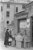 Bombed out Greengrocer's store. 26th April 1941 Photographic Print by  Staff