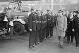 King George VI inspects firemen on his visit to Birmingham during WW2 Photographic Print by  Staff