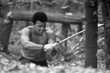 Muhammad Ali Chopping Down Trees as Part on His Training Routine Lámina fotográfica por Brendan Monks