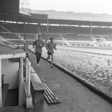 Manchester United Footballer George Best Running around a Snow Covered Pitch 1968 Photographic Print by Ernest Chapman