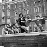 George Best with kids, Blackpool, 1970 Photographic Print by  Staff