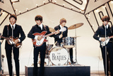 The Beatles Pop Group Performing on Stage at a Television Studio 1964 Fotoprint van  Staff