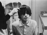 Mick Jagger having haircut at BBC, 1964 Photographic Print by  Staff