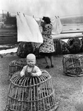 Baby in Lobster Pot, 1949 Reproduction photographique par  Staff