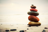 Stones Pyramid on Sand Symbolizing Zen, Harmony, Balance. Ocean in the Background Photographic Print by PHOTOCREO Michal Bednarek