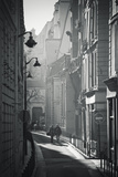 Two People Walking Up Sunny Side Street Near St Michel Notre Dame in Paris, France Photographic Print by Robert Such