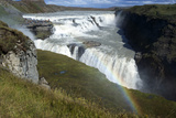 A Landscape View of Gullfoss Waterfall with a Faint Rainbow with People in the Background Photographic Print by Natalie Tepper