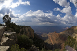Grand Canyon, Arizona, with the Sun Breaking Though a Dramatic Cloudy Sky Photographic Print by Mike Kirk