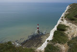 View of the Lighthouse at the Base of the White (Chalk) Cliffs at Beachy Head, East Sussex, England Photographic Print by Natalie Tepper