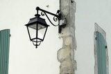Streetlamp on a Building with Shuttered Windows. Il De Re, France Photographic Print by Stuart Cox Olwen Croft