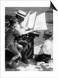Mann und Jungen mit einem Modellschiff, 1930er Jahre Prints by  Scherl