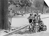 Children with Tricycles Play Near a Puddle in Washington Square Park. New York City Aug. 3, 1948 Plakaty