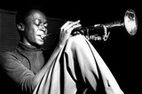 Miles Davis- Sitting With Trumpet Photo