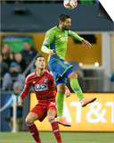 2014 MLS Playoffs: Nov 10, FC Dallas vs Seattle Sounders - Clint Dempsey, Matt Hedges Poster by Joe Nicholson
