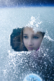 Girl Smiles Behind Frosted Window Photographic Print by Charles Bowman