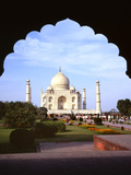Taj Mahal Through Ornate Arch Photographic Print by Charles Bowman