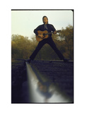 Country/Western Singer Johnny Cash with Guitar Straddling Railroad Tracks Metal Print by Michael Rougier
