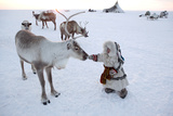 Nenya Vanuito, A 2 Year Nenets Girl, Approaches A Reindeer Photographic Print by Bryan and Cherry Alexander
