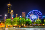 Ferris Wheel and Buildings Seen from Olympic Centennial Park at Night in Atlanta, Georgia. Photographic Print by Jon Bilous