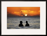 A Couple Watches the Sunset from the Waters Off Waikiki Beach During New Year's Eve in Honolulu Framed Photographic Print by Jason Reed