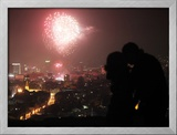 A Couple Kiss as Fireworks Light the Sky During New Year Celebrations in Sarajevo Framed Photographic Print by Dado Ruvic