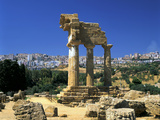 Temple of Diosuri, Agrigento, Sicily, Italy. Agrigento Town Behind Photographic Print by Peter Thompson