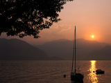 Yacht at Sunset, Lake Maggiore, Italy Photographic Print by Peter Thompson