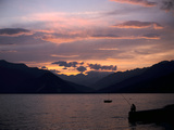 Fisherman at Sunset, Lake Maggiore, Italy Photographic Print by Peter Thompson
