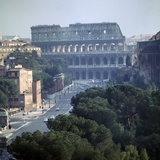 View of the Colosseum from the Victor Emmanuel II Monument, 1st Century Photographic Print by CM Dixon