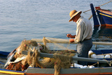 Man on Board a Fishing Boat, Sami, Kefalonia, Greece Photographic Print by Peter Thompson