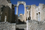 Distant Roman Capitol of Dougga Seen Through an Arch, 2nd Century Stampa fotografica di CM Dixon