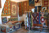 Rugs and Scarves at a Monastery, North Cyprus Photographic Print by Peter Thompson
