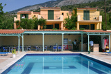 Holiday Apartments and Swimming Pool, Lourdas, Kefalonia, Greece Fotografisk tryk af Peter Thompson