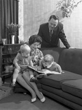 Family Group Looking at a Brochure, Doncaster, South Yorkshire, 1963 Photographic Print by Michael Walters