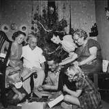Prisoner of War Home from a Korean Prison Camp Celebrating Christmas in August with His Family Stretched Canvas Print by Robert W. Kelley