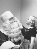 Santa Claus and 5 Year Old Demonstrating Right Way to Hold Child Photographic Print by Martha Holmes