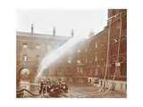 Firemen Demonstrating Hoses Worked by a Petrol Motor Pump, London Fire Brigade Headquarters, 1909 Photographic Print