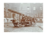 Firemen Aboard a Motor Fire Escape Vehicle, London Fire Brigade Headquarters, London, 1909 Photographic Print