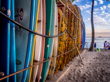 Colourful Surfboards Stacked up on Waikiki Beach at Sunset. Photographic Print by  Jeff