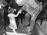Financier J.P. Morgan Politely Shakes Hands with a Little Lady, Lya Graf. Photo