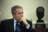 President George W. Bush During a Meeting in the Oval Office of the White House Photo