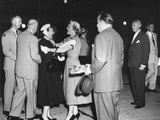 Pat Nixon Embraces Mamie Eisenhower at National Airport Photo