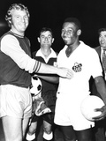 Pele of Santos of Brazil with Bobby Moore, the Halfback of West Ham United, England Photo