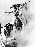 Graham Hill, Lifts Part of the Burning Wreckage to Clear Unconscious Peter Revson Photo