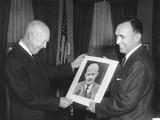 President Eisenhower Looks at a Prize-Winning Portrait of Him by its Creator Photo
