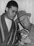 Mike Jacobs Inspects Joe Louis' Fist before the Heavy Weight Champion Photo
