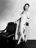 Norma Shearer, Modeling a Chiffon Evening Frock with an Uneven Hemline, 1929 Photo