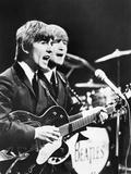 George Harrison (Left) and John Lennon of the Beatles Foto