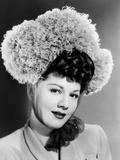 Maria Montez, Modeling a Bonnet of Grey Ostrich Feathers and Tulle, 1945 Photo